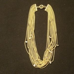Gold tone multi strand necklace with rindstones